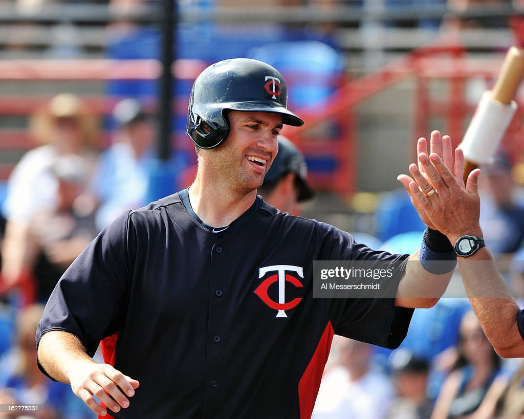 Catcher <a gi-track='captionPersonalityLinkClicked' href=/galleries/search?phrase=Joe+Mauer&family=editorial&specificpeople=214614 ng-click='$event.stopPropagation()'>Joe Mauer</a> #7 of the Minnesota Twins celebrates after scoring a run against the Toronto Blue Jays February 26, 2013 at the Florida Auto Exchange Stadium in Dunedin, Florida.