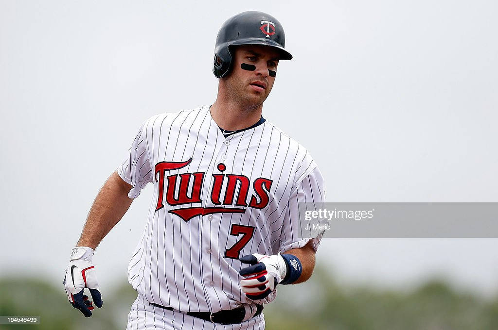 Catcher <a gi-track='captionPersonalityLinkClicked' href=/galleries/search?phrase=Joe+Mauer&family=editorial&specificpeople=214614 ng-click='$event.stopPropagation()'>Joe Mauer</a> #7 of the Minnesota Twins rounds the bases after his home run against the Toronto Blue Jays during a Grapefruit League Spring Training Game at Hammond Stadium on March 24, 2013 in Fort Myers, Florida.