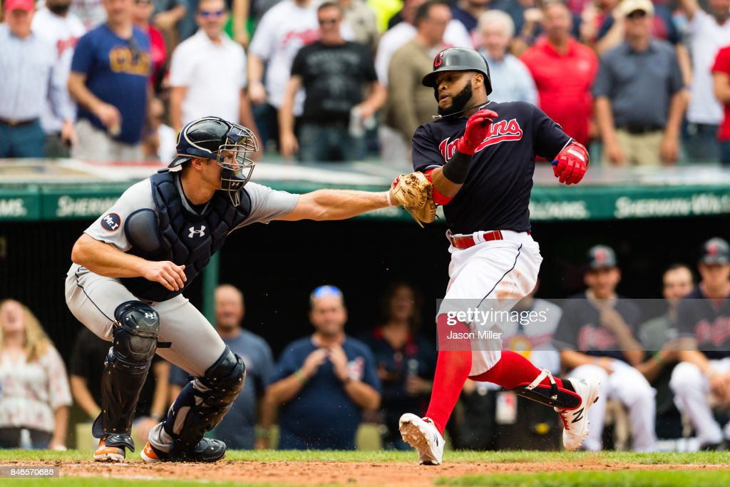 Catcher John Hicks #55 of the Detroit Tigers tags out Carlos Santana #41 of the Cleveland Indians at home to end the eighth inning at Progressive Field on September 13, 2017 in Cleveland, Ohio. The Indians defeated the Tigers to win 21 straight games.