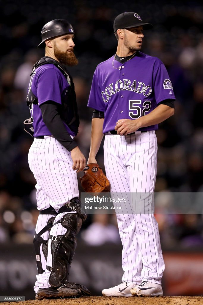 Catcher Jonathan Lucroy #21 and pitcher Chris Rusin #52 of the Colorado Rockies confer in the fifth inning against the Miami Marlins at Coors Field on September 25, 2017 in Denver, Colorado.