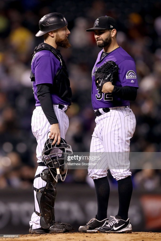 Catcher Jonathan Lucroy #21 and pitcher Tyler Chatwood #32 of the Colorado Rockies confer in the fifth inning against the Miami Marlins at Coors Field on September 25, 2017 in Denver, Colorado.