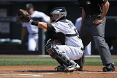 Catcher Jordan Pacheco of the Colorado Rockies backs up the plate against the Philadelphia Phillies at Coors Field on April 20 2014 in Denver...