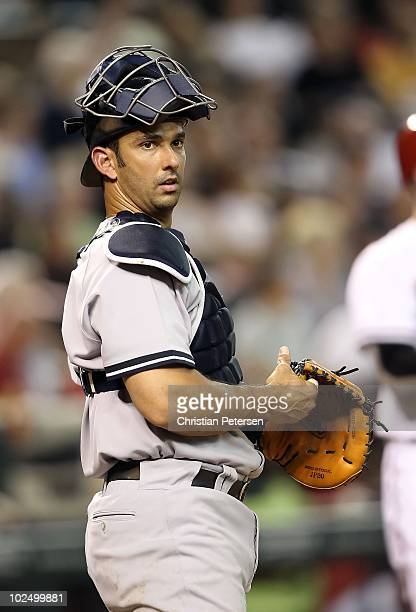 Catcher Jorge Posada of the New York Yankees in action during the Major League Baseball game against the Arizona Diamondbacks at Chase Field on June...