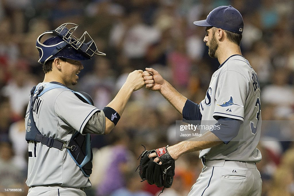 Catcher Jose Lobaton #21 of the Tampa Bay Rays celebrates with closing pitcher <a gi-track='captionPersonalityLinkClicked' href=/galleries/search?phrase=Burke+Badenhop&family=editorial&specificpeople=4901342 ng-click='$event.stopPropagation()'>Burke Badenhop</a> #31 after defeating the Cleveland Indians at Progressive Field on July 6, 2012 in Cleveland, Ohio. The Rays defeated the Indians 10-3.