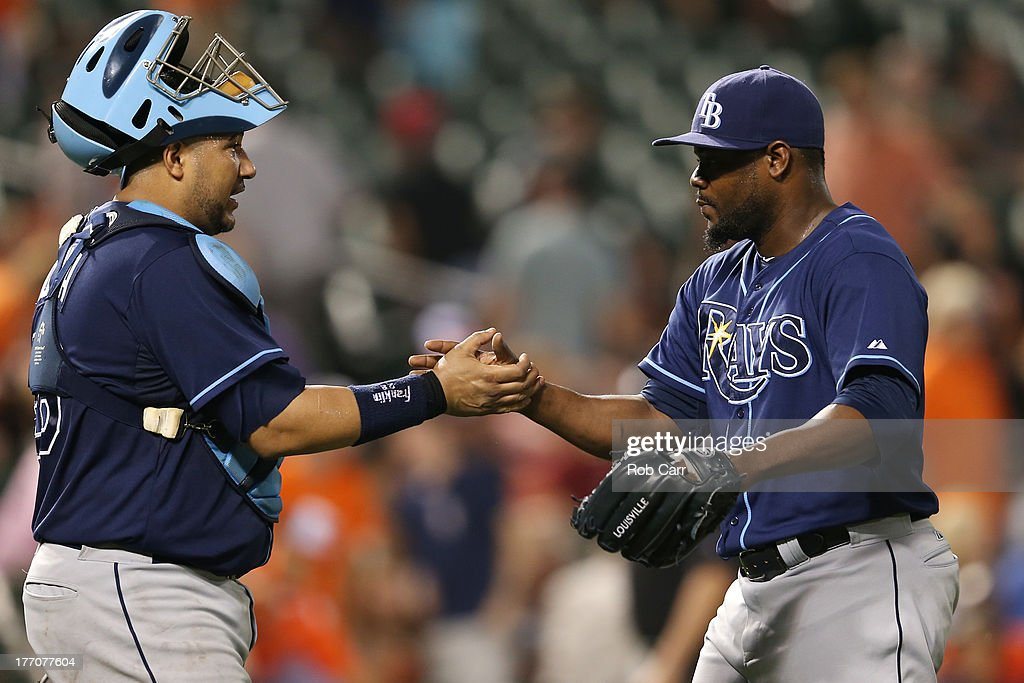 Catcher <a gi-track='captionPersonalityLinkClicked' href=/galleries/search?phrase=Jose+Molina&family=editorial&specificpeople=206365 ng-click='$event.stopPropagation()'>Jose Molina</a> #28 and pitcher <a gi-track='captionPersonalityLinkClicked' href=/galleries/search?phrase=Fernando+Rodney&family=editorial&specificpeople=547291 ng-click='$event.stopPropagation()'>Fernando Rodney</a> #56 of the Tampa Bay Rays celebrate after the Rays defeated the Baltimore Orioles 7-4 at Oriole Park at Camden Yards on August 20, 2013 in Baltimore, Maryland.