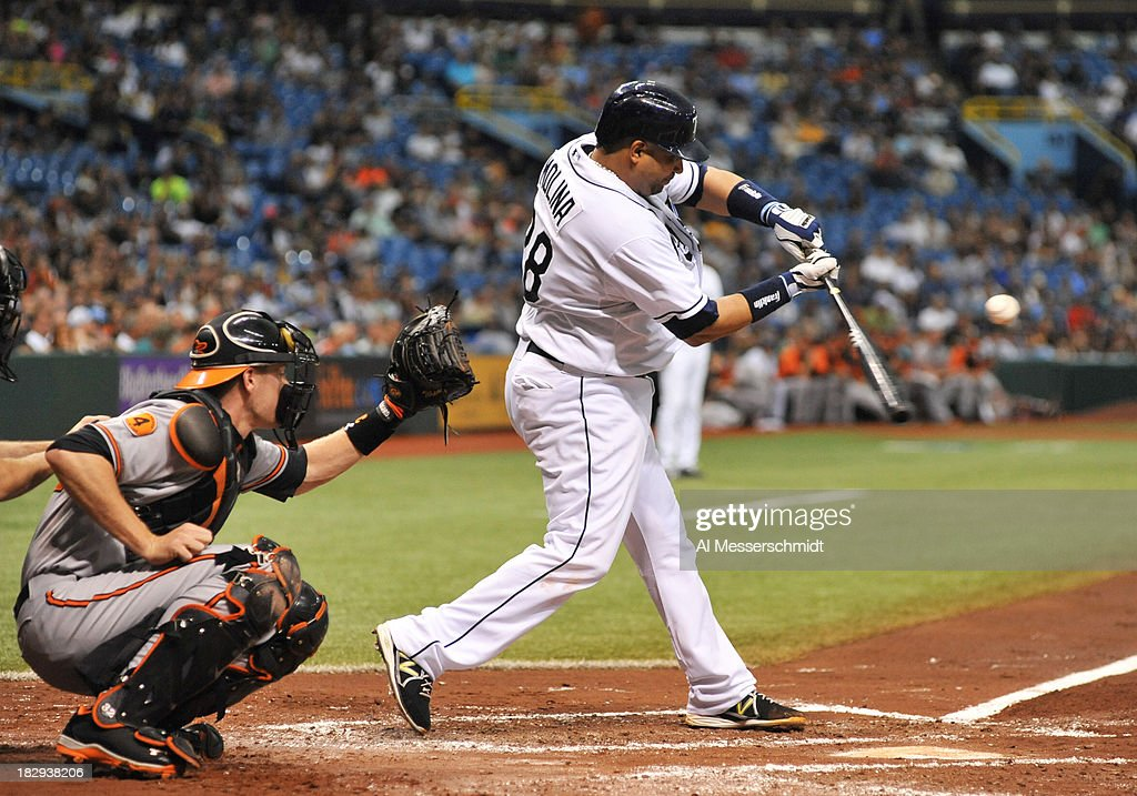 Catcher <a gi-track='captionPersonalityLinkClicked' href=/galleries/search?phrase=Jose+Molina&family=editorial&specificpeople=206365 ng-click='$event.stopPropagation()'>Jose Molina</a> #28 of the Tampa Bay Rays bats against the Baltimore Orioles September 23, 2013 at Tropicana Field in St. Petersburg, Florida. The Rays won 5 - 4.