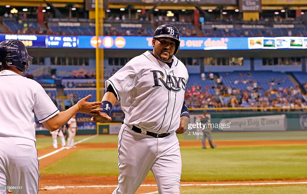 Catcher <a gi-track='captionPersonalityLinkClicked' href=/galleries/search?phrase=Jose+Molina&family=editorial&specificpeople=206365 ng-click='$event.stopPropagation()'>Jose Molina</a> #28 of the Tampa Bay Rays is congratulated after scoring in the eighth inning against the Arizona Diamondbacks during the game at Tropicana Field on July 30, 2013 in St. Petersburg, Florida.