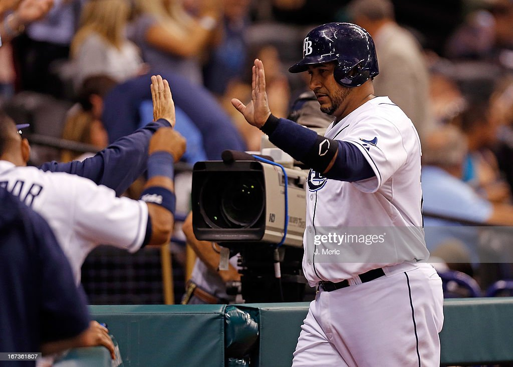Catcher <a gi-track='captionPersonalityLinkClicked' href=/galleries/search?phrase=Jose+Molina&family=editorial&specificpeople=206365 ng-click='$event.stopPropagation()'>Jose Molina</a> #28 of the Tampa Bay Rays is congratulated after scoring against the New York Yankees during the game at Tropicana Field on April 24, 2013 in St. Petersburg, Florida.