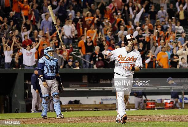 Catcher Jose Molina of the Tampa Bay Rays looks on as Matt Wieters of the Baltimore Orioles flips his bat and follows his walk off grand slam to give...
