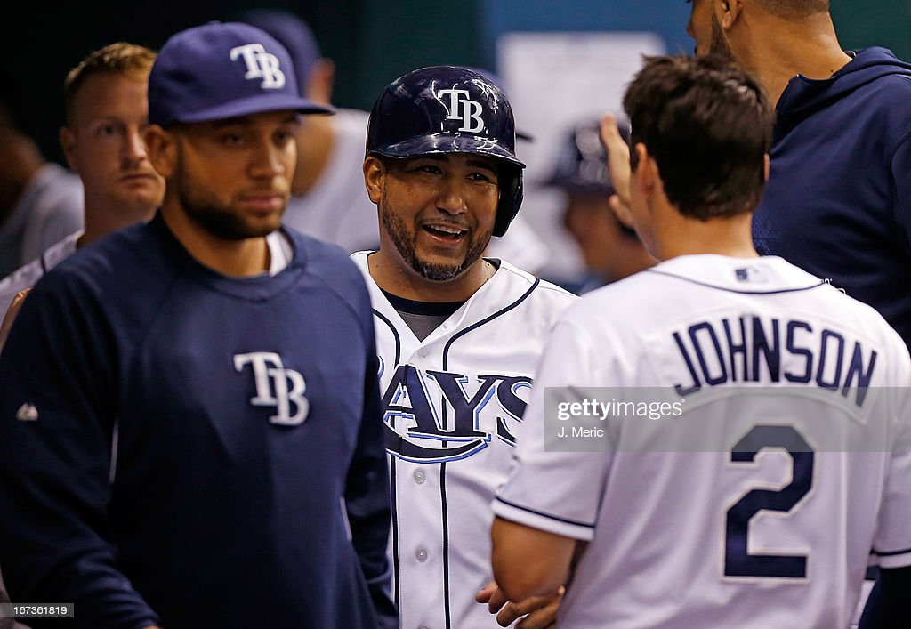 Catcher <a gi-track='captionPersonalityLinkClicked' href=/galleries/search?phrase=Jose+Molina&family=editorial&specificpeople=206365 ng-click='$event.stopPropagation()'>Jose Molina</a> #28 of the Tampa Bay Rays smiles after scoring a fifth inning run against the New York Yankees during the game at Tropicana Field on April 24, 2013 in St. Petersburg, Florida.