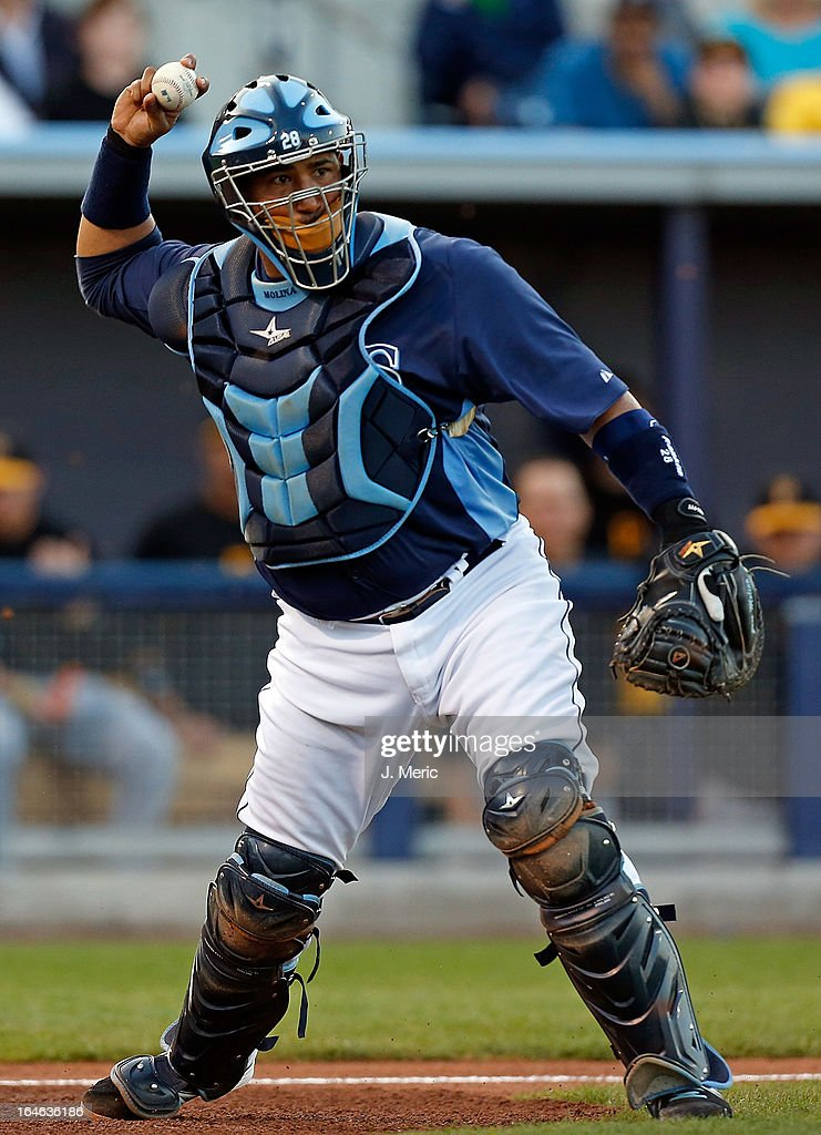 Catcher <a gi-track='captionPersonalityLinkClicked' href=/galleries/search?phrase=Jose+Molina&family=editorial&specificpeople=206365 ng-click='$event.stopPropagation()'>Jose Molina</a> #28 of the Tampa Bay Rays throws over to first for an out against the Pittsburgh Pirates during a Grapefruit League Spring Training Game at the Charlotte Sports Complex on March 25, 2013 in Port Charlotte, Florida.