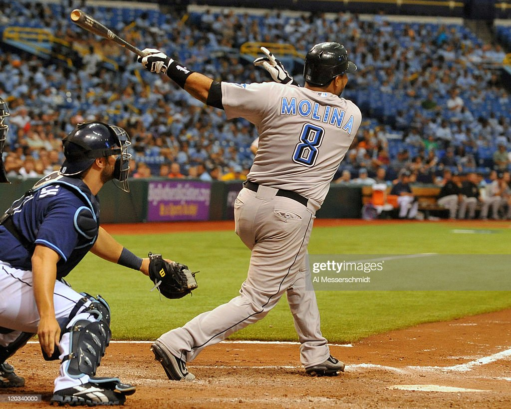 Catcher Jose Molina #8 of the Toronto Blue Jays triples to drive in two runs in the 11th inning against the Tampa Bay Rays August 4, 2011 at Tropicana Field in St. Petersburg, Florida.