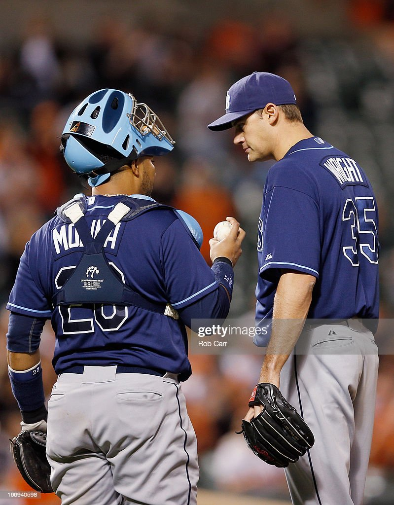 Catcher Jose Molina #28 talks with pitcher <a gi-track='captionPersonalityLinkClicked' href=/galleries/search?phrase=Jamey+Wright&family=editorial&specificpeople=220683 ng-click='$event.stopPropagation()'>Jamey Wright</a> #35 of the Tampa Bay Rays during the ninth inning against the Baltimore Orioles at Oriole Park at Camden Yards on April 18, 2013 in Baltimore, Maryland. The Orioles won 10-6 in ten innings.