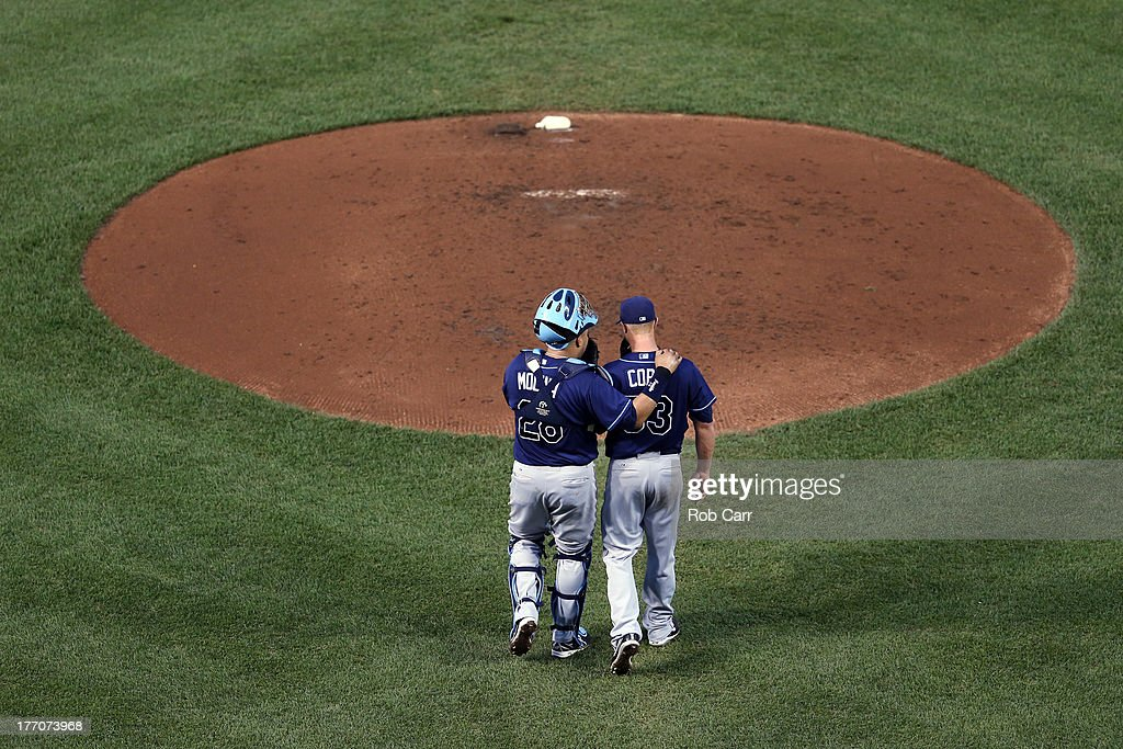 Catcher <a gi-track='captionPersonalityLinkClicked' href=/galleries/search?phrase=Jose+Molina&family=editorial&specificpeople=206365 ng-click='$event.stopPropagation()'>Jose Molina</a> #28 talks with starting pitcher <a gi-track='captionPersonalityLinkClicked' href=/galleries/search?phrase=Alex+Cobb&family=editorial&specificpeople=7512114 ng-click='$event.stopPropagation()'>Alex Cobb</a> #53 of the Tampa Bay Rays during the third inning against the Baltimore Orioles at Oriole Park at Camden Yards on August 20, 2013 in Baltimore, Maryland.
