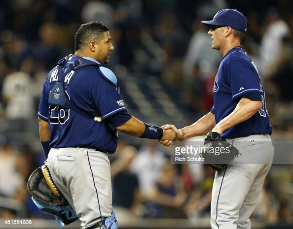 Catcher Jose Molina the Tampa Bay Rays congratulates closer Grant Balfour after a 21 win over the New York Yankees at Yankee Stadium on July 1 2014...
