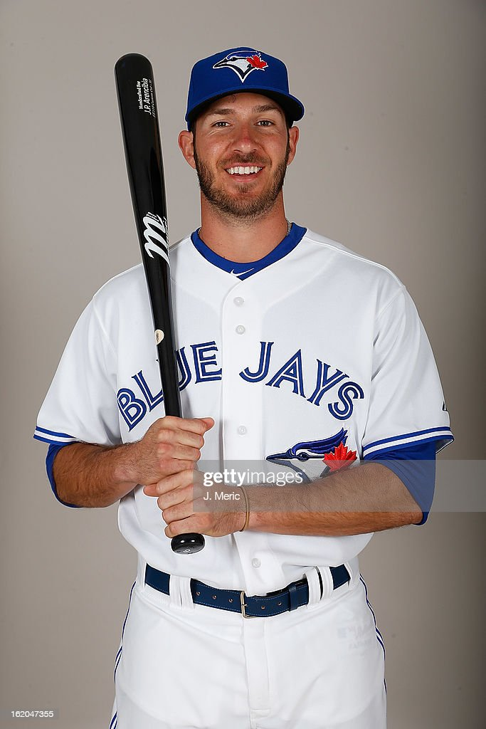 Catcher <a gi-track='captionPersonalityLinkClicked' href=/galleries/search?phrase=J.P.+Arencibia&family=editorial&specificpeople=4959430 ng-click='$event.stopPropagation()'>J.P. Arencibia</a> #9 of the Toronto Blue Jays poses for a photo during photo day at Florida Auto Exchange Stadium on February 18, 2013 in Dunedin, Florida.