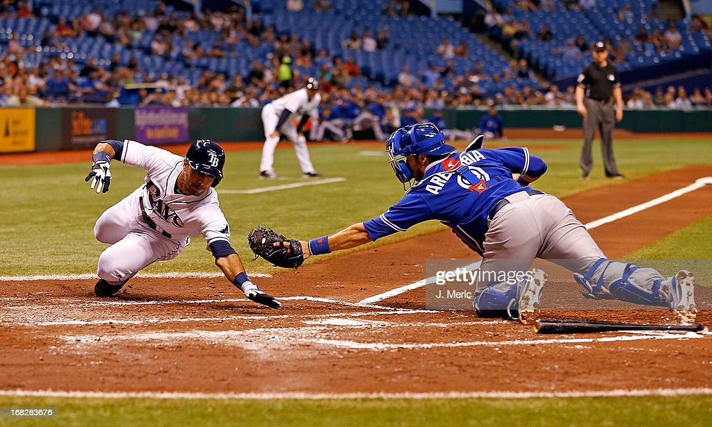 Catcher <a gi-track='captionPersonalityLinkClicked' href=/galleries/search?phrase=J.P.+Arencibia&family=editorial&specificpeople=4959430 ng-click='$event.stopPropagation()'>J.P. Arencibia</a> #9 of the Toronto Blue Jays stretches but does not initially tag <a gi-track='captionPersonalityLinkClicked' href=/galleries/search?phrase=Sean+Rodriguez&family=editorial&specificpeople=4171805 ng-click='$event.stopPropagation()'>Sean Rodriguez</a> #1 of the Tampa Bay Rays during the game at Tropicana Field on May 7, 2013 in St. Petersburg, Florida.