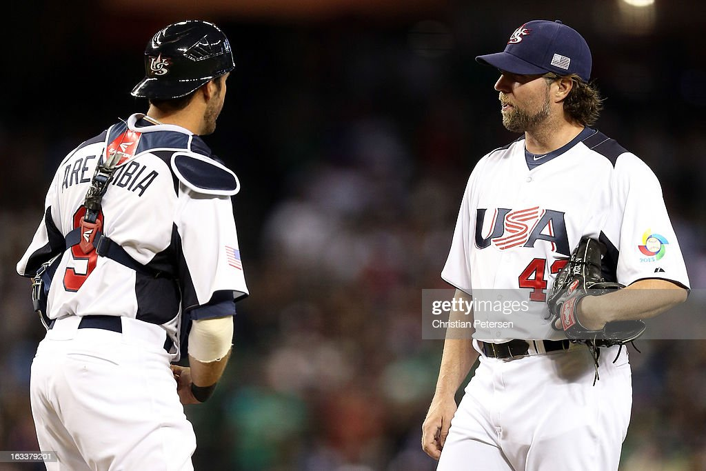Catcher J.P. Arencibia #9 of the United States with pitcher R.A. Dickey #43 in the third inning against Mexico during the World Baseball Classic First Round Group D game at Chase Field on March 8, 2013 in Phoenix, Arizona.