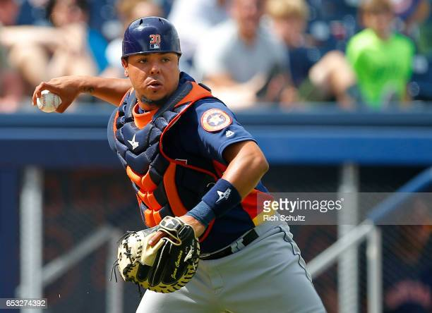 Catcher Juan Centeno of the Houston Astros attempts to throw out Trea Turner of the Washington Nationals who safely made it to first base for an...