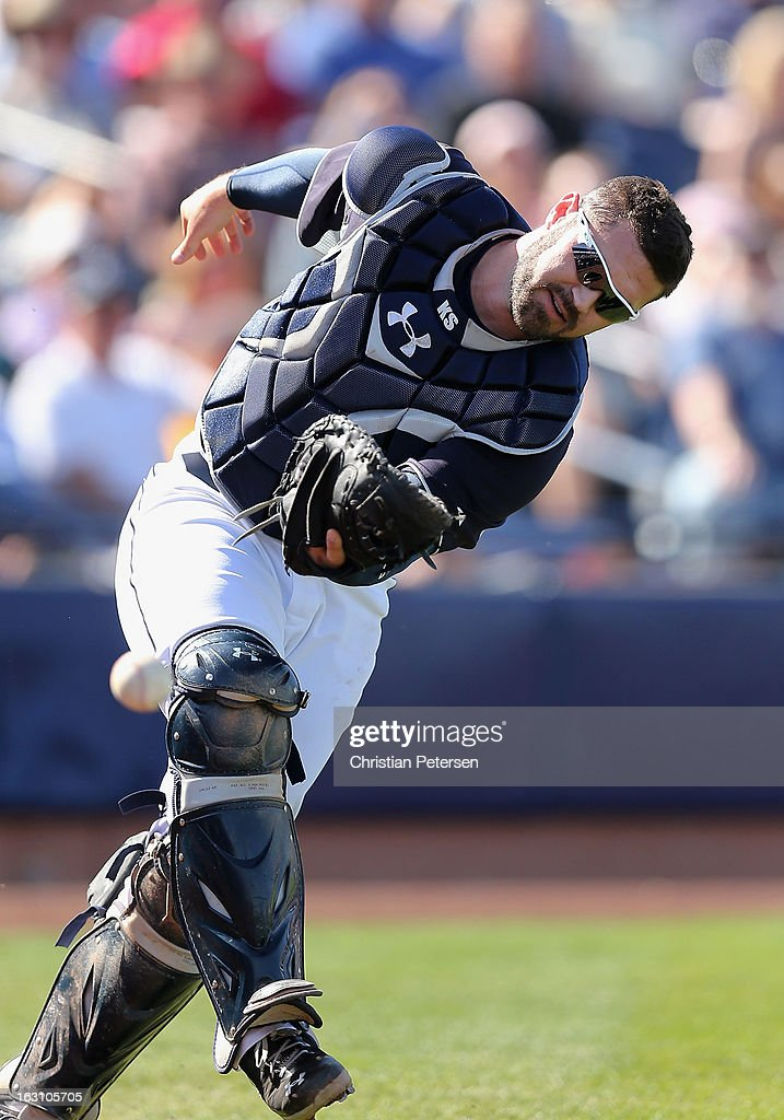 Catcher <a gi-track='captionPersonalityLinkClicked' href=/galleries/search?phrase=Kelly+Shoppach&family=editorial&specificpeople=194967 ng-click='$event.stopPropagation()'>Kelly Shoppach</a> #7 of the Seattle Mariners drops a foul ball during the fourth inning of the spring training game against the Colorado Rockies at Peoria Stadium on March 4, 2013 in Peoria, Arizona.
