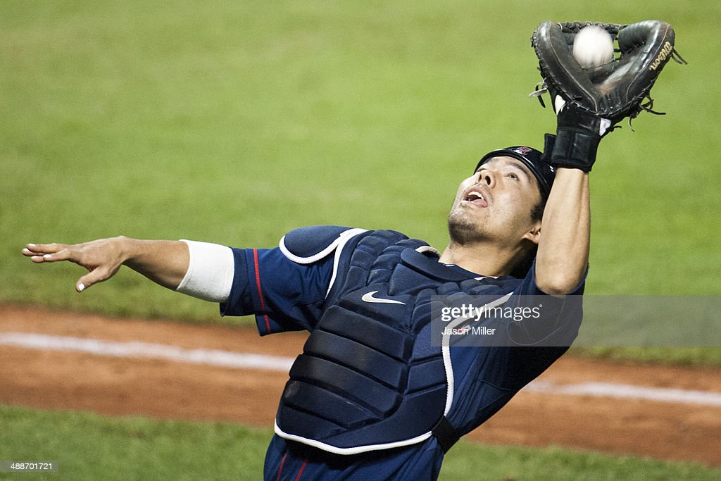 Catcher <a gi-track='captionPersonalityLinkClicked' href=/galleries/search?phrase=Kurt+Suzuki&family=editorial&specificpeople=682702 ng-click='$event.stopPropagation()'>Kurt Suzuki</a> #8 of the Minnesota Twins catches a fly ball hit by Mike Aviles #4 of the Cleveland Indians during the seventh inning at Progressive Field on May 7, 2014 in Cleveland, Ohio. The Indians defeated the Twins 4-3.