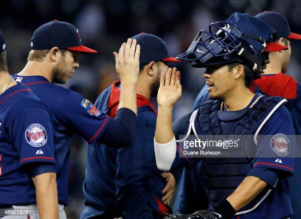Catcher Kurt Suzuki of the Minnesota Twins celebrates their 21 win over the Detroit Tigers with pitcher Casey Fien at Comerica Park on May 9 2014 in...