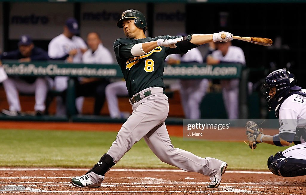 Catcher <a gi-track='captionPersonalityLinkClicked' href=/galleries/search?phrase=Kurt+Suzuki&family=editorial&specificpeople=682702 ng-click='$event.stopPropagation()'>Kurt Suzuki</a> #8 of the Oakland Athletics bats against the Tampa Bay Rays during the game at Tropicana Field on August 6, 2011 in St. Petersburg, Florida.