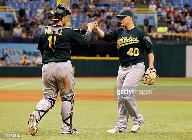 Catcher Landon Powell of the Oakland Athletics congratulates pitcher Andrew Bailey just after the game against the Tampa Bay Rays at Tropicana Field...