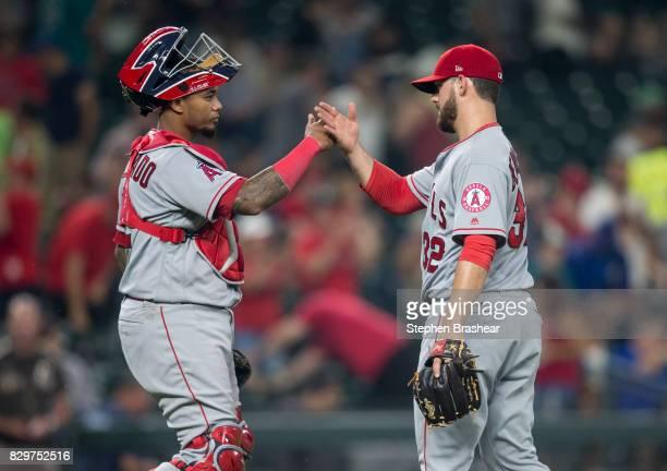 Catcher Martin Maldonado of the Los Angeles Angels of Anaheim congratulates relief pitcher Cam Bedrosian of the Los Angeles Angels of Anaheim after a...