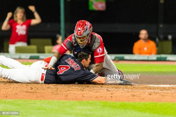 Catcher Martin Maldonado of the Los Angeles Angels of Anaheim tags out Bradley Zimmer of the Cleveland Indians at home to end the seventh inning at...