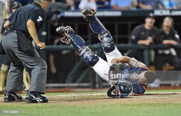 Catcher Matt Thaiss of the Virginia Cavaliers calls back as he catches the final out against the Vanderbilt Commodores in the sixth inning during...
