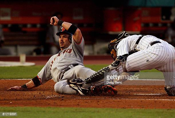 Catcher Matt Treanor of the Florida Marlins can't block the plate as Aaron Rowand of the San Francisco Giants scores on a double by Rich Aurilia in...
