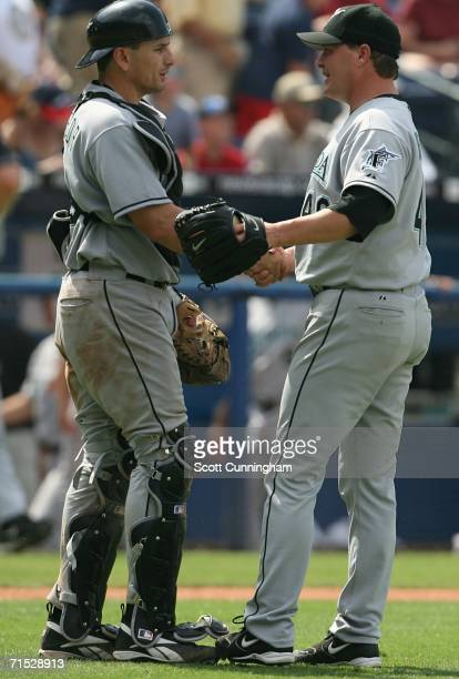 Catcher Matt Treanor of the Florida Marlins congratulates relief pitcher Matt Herges after their win over the Atlanta Braves at Turner Field on July...