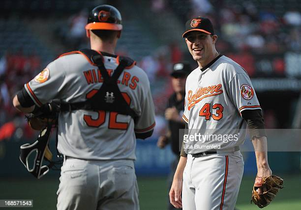 Catcher Matt Wieters and pitcher Jim Johnson of the Baltimore Orioles celebrate defeating the Los Angeles Angels of Anaheim 54 at Angel Stadium of...