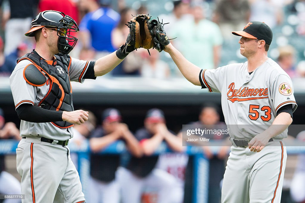 Catcher <a gi-track='captionPersonalityLinkClicked' href=/galleries/search?phrase=Matt+Wieters&family=editorial&specificpeople=4498276 ng-click='$event.stopPropagation()'>Matt Wieters</a> #32 celebrates with closing pitcher <a gi-track='captionPersonalityLinkClicked' href=/galleries/search?phrase=Zach+Britton&family=editorial&specificpeople=7091505 ng-click='$event.stopPropagation()'>Zach Britton</a> #53 of the Baltimore Orioles after the Orioles defeated the Indians at Progressive Field on May 29, 2016 in Cleveland, Ohio. The Orioles defeated the Indians 6-4.