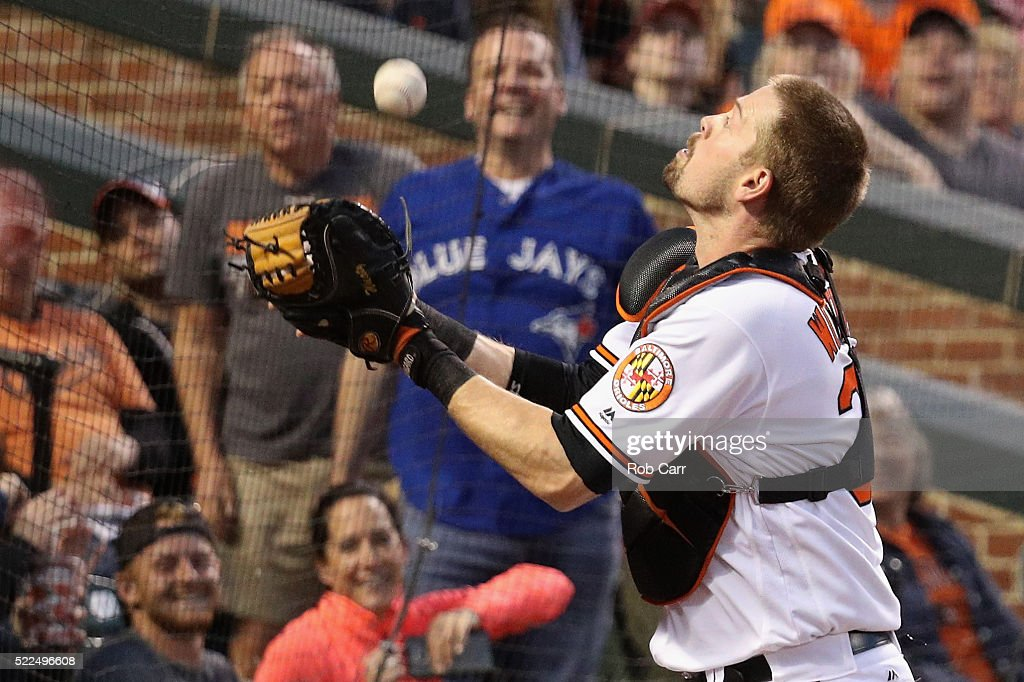 Catcher <a gi-track='captionPersonalityLinkClicked' href=/galleries/search?phrase=Matt+Wieters&family=editorial&specificpeople=4498276 ng-click='$event.stopPropagation()'>Matt Wieters</a> #32 of the Baltimore Orioles catches a foul ball hit by Edwin Encarnacion #10 of the Toronto Blue Jays (not pictured) for the second out of the third inning at Oriole Park at Camden Yards on April 19, 2016 in Baltimore, Maryland.