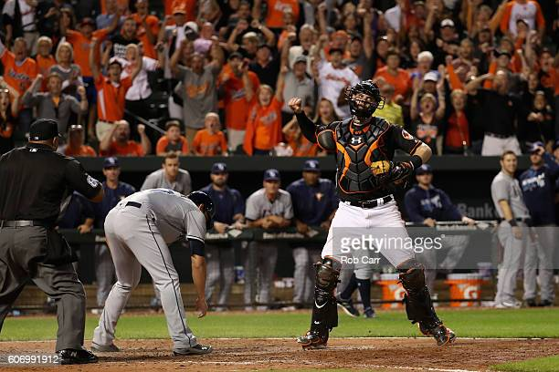 Catcher Matt Wieters of the Baltimore Orioles celebrates after tagging out Mikie Mahtook of the Tampa Bay Rays for the last out of the game during...