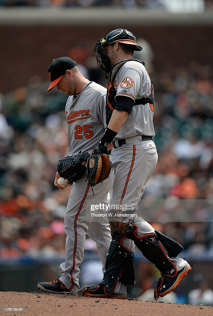 Catcher <a gi-track='captionPersonalityLinkClicked' href=/galleries/search?phrase=Matt+Wieters&family=editorial&specificpeople=4498276 ng-click='$event.stopPropagation()'>Matt Wieters</a> #32 of the Baltimore Orioles comes out to talk with pitcher <a gi-track='captionPersonalityLinkClicked' href=/galleries/search?phrase=Bud+Norris&family=editorial&specificpeople=5746311 ng-click='$event.stopPropagation()'>Bud Norris</a> #25 after Norris gave up a double to Marco Scutaro #19 of the San Francisco Giants in the second inning at AT&T Park on August 11, 2013 in San Francisco, California.