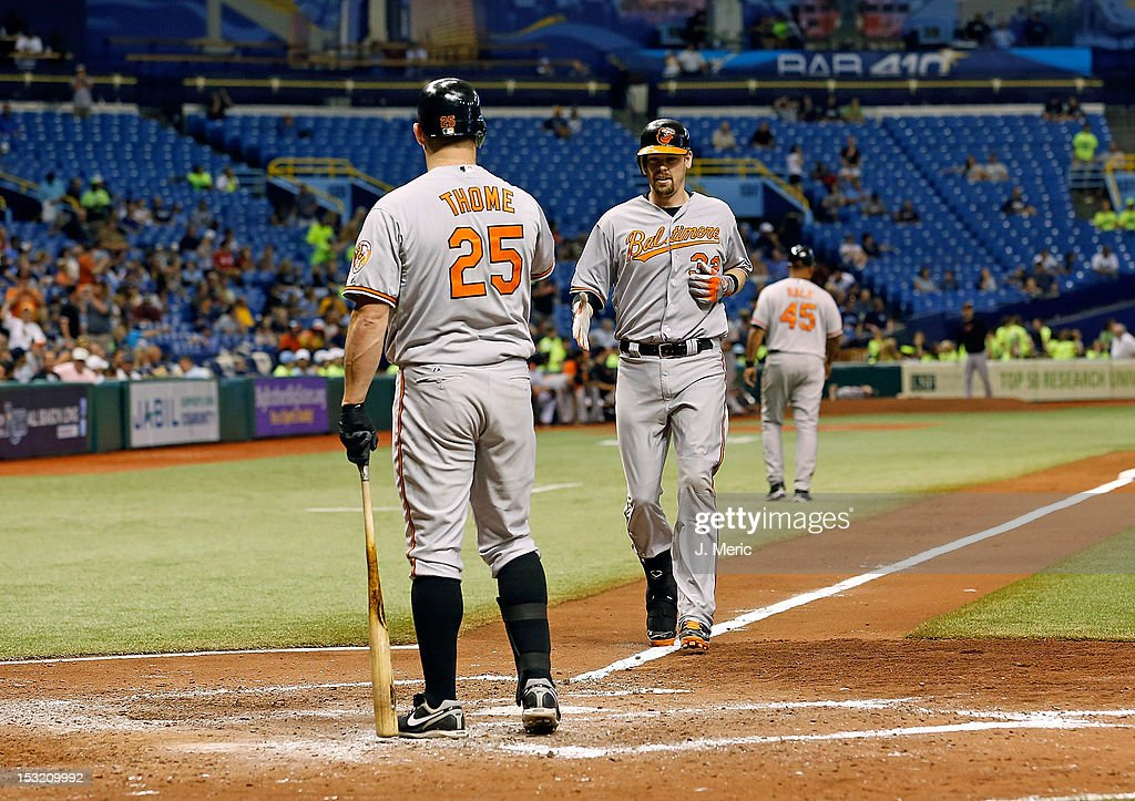 Catcher <a gi-track='captionPersonalityLinkClicked' href=/galleries/search?phrase=Matt+Wieters&family=editorial&specificpeople=4498276 ng-click='$event.stopPropagation()'>Matt Wieters</a> #32 of the Baltimore Orioles is congratulated by <a gi-track='captionPersonalityLinkClicked' href=/galleries/search?phrase=Jim+Thome&family=editorial&specificpeople=202878 ng-click='$event.stopPropagation()'>Jim Thome</a> #25 after his home run against the Tampa Bay Rays during the game at Tropicana Field on October 1, 2012 in St. Petersburg, Florida.