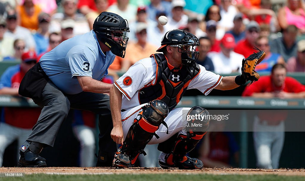 Catcher <a gi-track='captionPersonalityLinkClicked' href=/galleries/search?phrase=Matt+Wieters&family=editorial&specificpeople=4498276 ng-click='$event.stopPropagation()'>Matt Wieters</a> #32 of the Baltimore Orioles misses a ball against the Philadelphia Phillies during a Grapefruit League Spring Training Game at Ed Smith Stadium on March 23, 2013 in Sarasota, Florida.