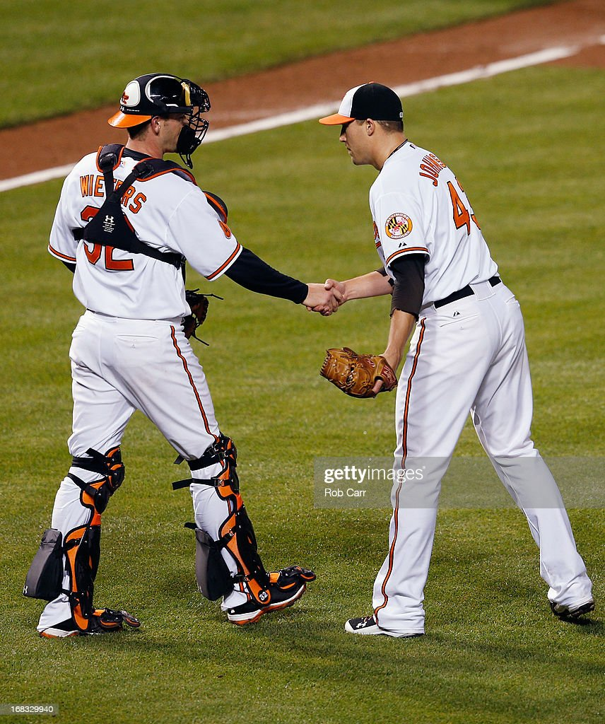 Catcher <a gi-track='captionPersonalityLinkClicked' href=/galleries/search?phrase=Matt+Wieters&family=editorial&specificpeople=4498276 ng-click='$event.stopPropagation()'>Matt Wieters</a> #32 shakes hands with closer Jim Johnson #43 of the Baltimore Orioles after the Orioles defeated the Kansas City Royals 5-3 at Oriole Park at Camden Yards on May 8, 2013 in Baltimore, Maryland.
