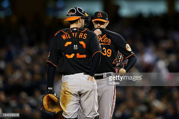 Catcher Matt Wieters talks with pitcher Jason Hammel of the Baltimore Orioles against the New York Yankees during Game Five of the American League...