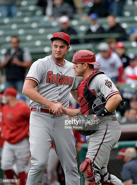 Catcher Miguel Montero and relief pitcher Addison Reed of the Arizona Diamondbacks celebrate a win over the Chicago Cubs at Wrigley Field on April 24...