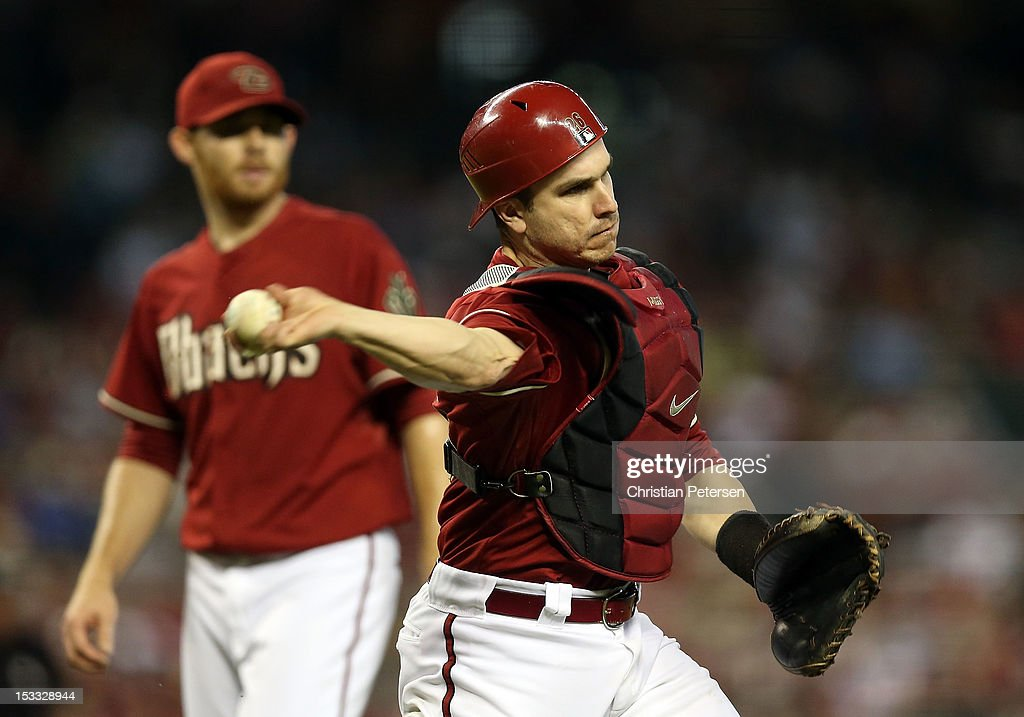 Catcher Miguel Montero #26 of the Arizona Diamondbacks fields a ground ball out against the Colorado Rockies during the MLB game at Chase Field on October 3, 2012 in Phoenix, Arizona.