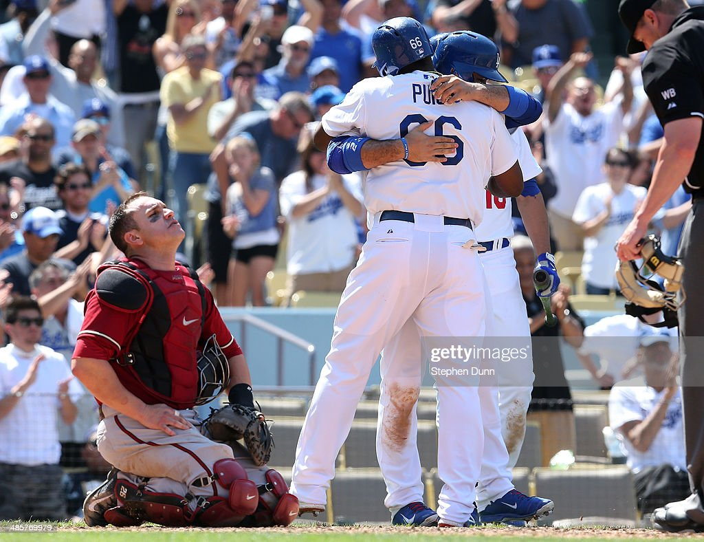 Catcher <a gi-track='captionPersonalityLinkClicked' href=/galleries/search?phrase=Miguel+Montero&family=editorial&specificpeople=836495 ng-click='$event.stopPropagation()'>Miguel Montero</a> #26 of the Arizona Diamondbacks reacts as <a gi-track='captionPersonalityLinkClicked' href=/galleries/search?phrase=Yasiel+Puig&family=editorial&specificpeople=10484087 ng-click='$event.stopPropagation()'>Yasiel Puig</a> #66 of the Los Angeles Dodgers celebrates his sixth inning three run home run with teammates at Dodger Stadium on April 20, 2014 in Los Angeles, California.