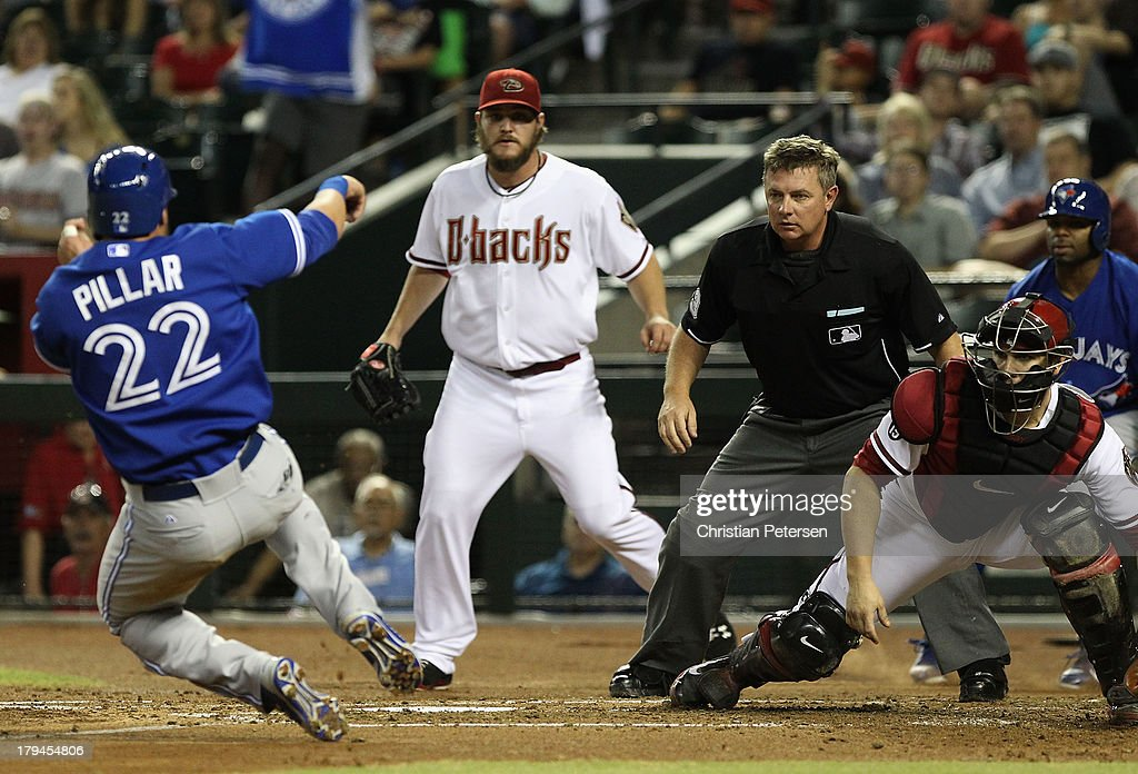Catcher <a gi-track='captionPersonalityLinkClicked' href=/galleries/search?phrase=Miguel+Montero&family=editorial&specificpeople=836495 ng-click='$event.stopPropagation()'>Miguel Montero</a> #26 of the Arizona Diamondbacks waits for the throw as Kevin Pillar #22 of the Toronto Blue Jays slides into home plate to score a run during the second inning of the interleague MLB game at Chase Field on September 3, 2013 in Phoenix, Arizona.