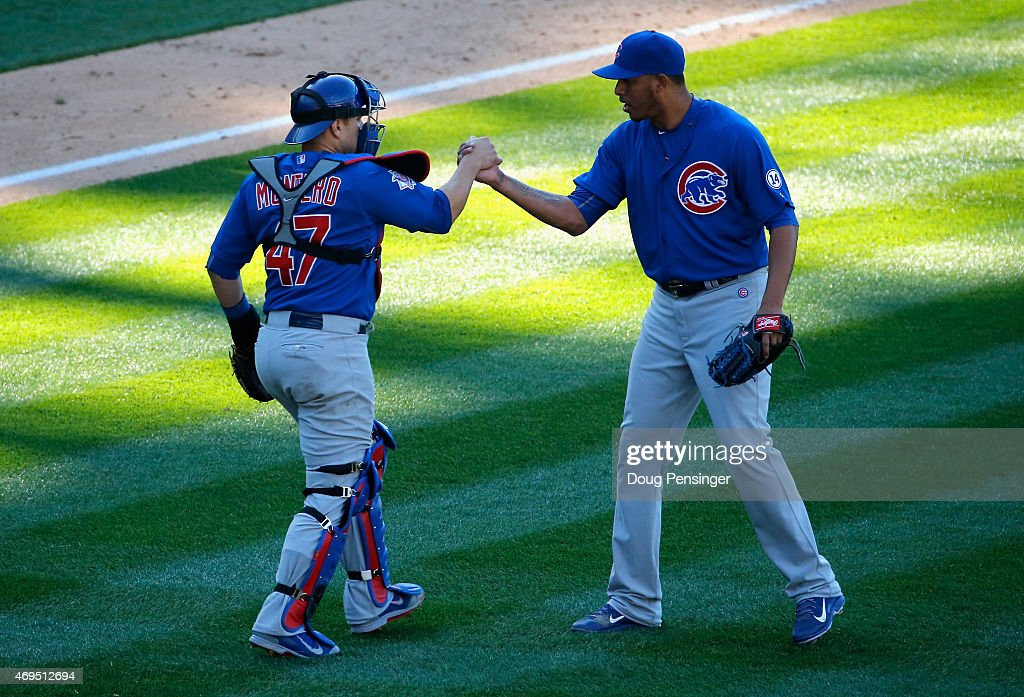 Catcher Miguel Montero #47 of the Chicago Cubs and pitcher Hector Rondon #56 of the Chicago Cubs celebrate their 6-5 victory over the Colorado Rockies at Coors Field on April 12, 2015 in Denver, Colorado.