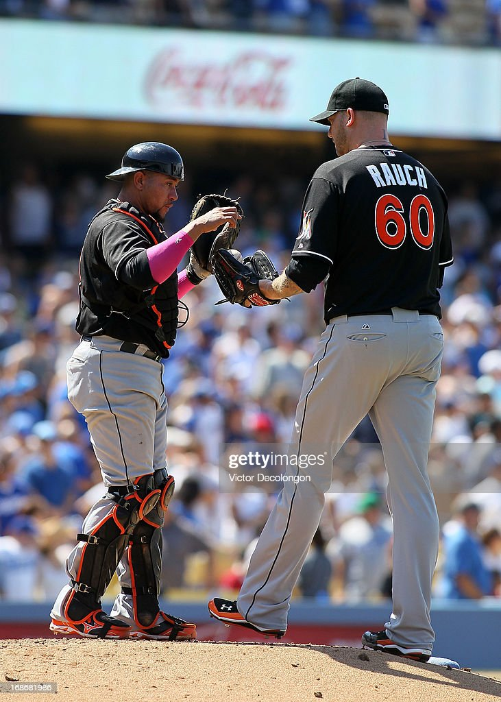 Catcher <a gi-track='captionPersonalityLinkClicked' href=/galleries/search?phrase=Miguel+Olivo&family=editorial&specificpeople=209185 ng-click='$event.stopPropagation()'>Miguel Olivo</a> #21 of the Miami Marlins gives the ball to relief pitcher <a gi-track='captionPersonalityLinkClicked' href=/galleries/search?phrase=Jon+Rauch&family=editorial&specificpeople=242989 ng-click='$event.stopPropagation()'>Jon Rauch</a> #60 in the seventh inning during the MLB game against the Los Angeles Dodgers at Dodger Stadium on May 12, 2013 in Los Angeles, California. The Dodgers defeated the Marlins 5-3.