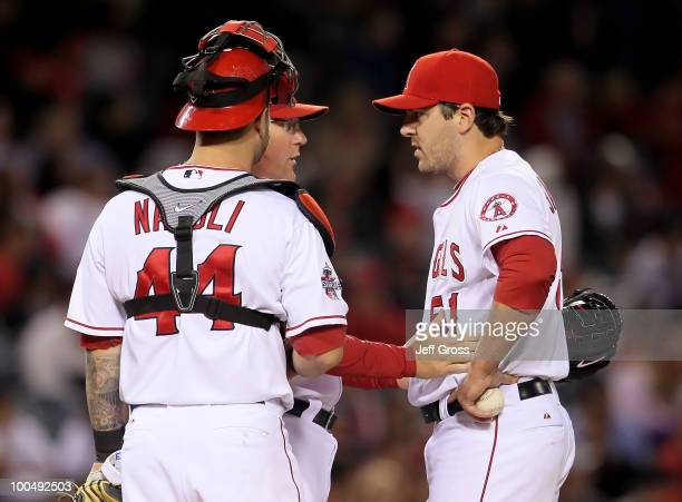 Catcher Mike Napoli and pitching coach Mike Butcher talk to Joe Saunders of the Los Angeles Angels of Anaheim in the third inning against the Toronto...
