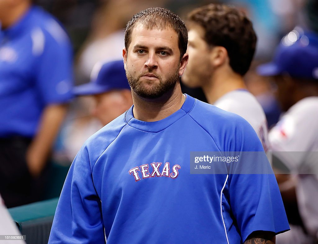 Catcher <a gi-track='captionPersonalityLinkClicked' href=/galleries/search?phrase=Mike+Napoli&family=editorial&specificpeople=525007 ng-click='$event.stopPropagation()'>Mike Napoli</a> #25 of the Texas Rangers walks the dugout during the game against the Tampa Bay Rays at Tropicana Field on September 8, 2012 in St. Petersburg, Florida.